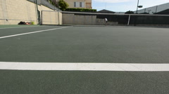 Tracking dolly shot of an ace tennis serve. Stock Footage