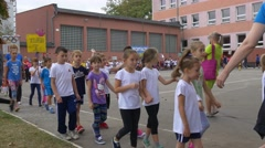 Boys and Girls Accompany Their Coach Stock Footage