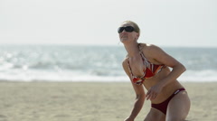 Close-up of a female beach volleyball player passing the ball in a bikini. Stock Footage
