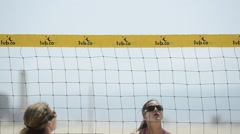 Close-up of women beach volleyball players spiking and blocking the ball at the Stock Footage