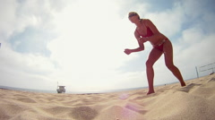 A woman beach volleyball player diving for the ball. Stock Footage