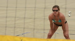 Close-up selective-focus of a woman beach volleyball player passing the ball. Stock Footage