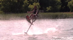 A man crashes in the water while trying to do a risky trick on his hydrofoil wat Stock Footage
