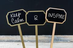 Keep Calm and Inspire message written with chalk on mini blackboard labels Kuvituskuvat