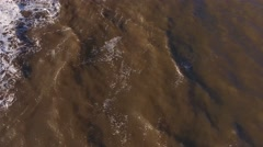 Aerial view of brown muddy sea water. Stock Footage