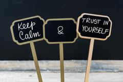 Keep Calm and Trust In Yourself message written with chalk on mini blackboard Stock Photos