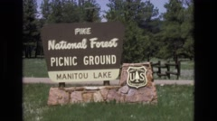 1966: a brown sign greets visitors to a national forest LAKE TAHOE NEVADA Stock Footage