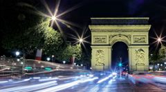 Arch of Arc de Triomphe at night, Paris, France, Traffic time lapse short pan Stock Footage