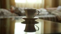 Closeup cup of hot tea or coffee, young sexy woman waking up stretching arms Stock Footage
