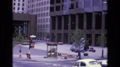 1968: view of bottom floors of urban buildings and the sidewalk and street Stock Footage