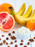 Dieting cottage cheese with fresh fruits and nuts Stock Photos