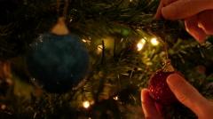 Hanging Christmas Ball On Tree Stock Footage