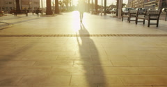4K Beautiful woman walking through city in the summer as the sun begins to set Stock Footage