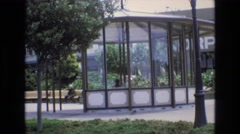 1968: garden scenery with a gazebo in middle glass doors SAN FRANCISCO Stock Footage