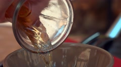 Zoom on pouring drinks in glass Stock Footage