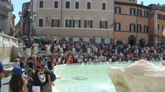 ROME, ITALY - SEPTEMBER 4, 2016. Tourists visiting the Trevi Fountain Stock Footage