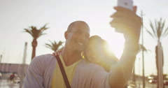 4K Happy romantic couple posing for selfie outdoors in the city Stock Footage