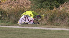 Homeless person living in a tent on city street in downtown Toronto Stock Footage
