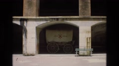 1968: an old covered wagon featured within the walls of a structure  Stock Footage