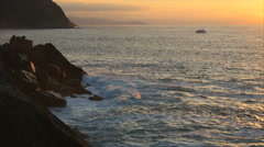 Ocean waves at sunset at San Sebastian, Spain Stock Footage