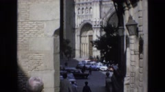 1969: the entrance of a magnificent old fort with many people visiting SPAIN Stock Footage