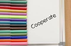 Cooperate text concept Stock Photos