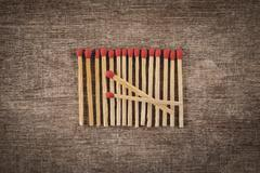 Pile of matchsticks arrange in a row Stock Photos