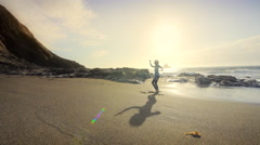 Young woman performing Tai Chi on beach at sunset, Oregon Arkistovideo