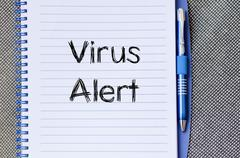 Virus alert text concept on notebook Stock Photos