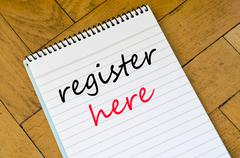 Register here text concept on notebook Stock Photos