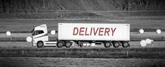 Truck driving through a rural area - Delivery Stock Photos