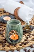 Aroma lamp with coffee essential oil, spa background, vertical Stock Photos