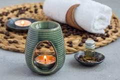 Aroma lamp with coffee essential oil, spa background, horizontal Stock Photos
