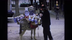 1969: selling items off of a mule SPAIN Stock Footage
