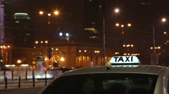 The taxi symbol on the background of night city traffic in the snow Stock Footage