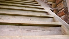 A wooden staircase upstairs in a wooden cottage. Stock Footage