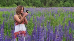 Attractive model make selfie and posing for a photograph. Stock Footage