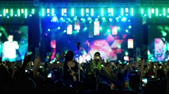 People at the concert remove the mobile phone scene, fans waving their hands Stock Footage