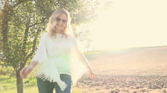 Woman in the morning before brown field with Sunflare Stock Footage