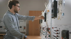 Male academic specialist makes experiment in laboratory Stock Footage