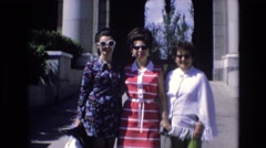 1969: three women with sunglasses standing in front of a large structure SPAIN Stock Footage
