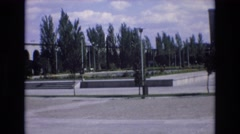 1969: community square in foreground as cars pass by SPAIN Stock Footage