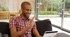 4k, Happy attractive African, American young man having a video chat on his tabl Stock Footage