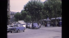 1969: view of cars and buses traveling down a busy street Stock Footage