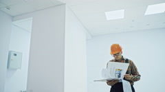 Worker checking documents in finished room Stock Footage