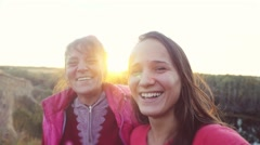 Portrait of mother and daughter hugging laugh and play the fool on a sunny day Stock Footage