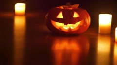 Helloween pumpkin and candles Stock Footage