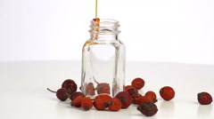 Rosehip oil is poured into the bottle Stock Footage