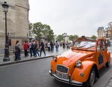 Old Citroen 2CV parked at cathedral Notre-Dame de Paris, France. Stock Photos