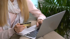 Attractive young woman doing online purchases uses gold credit card. Stock Footage